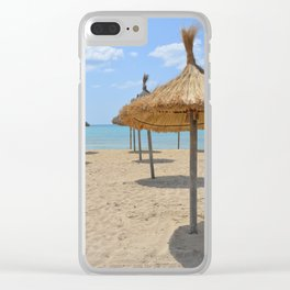 Parasols in a row on a sunny beach Clear iPhone Case