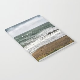 Land and sea under stormy clouds Notebook