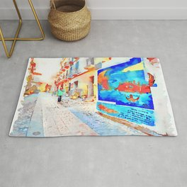 Man in the street with murals Rug