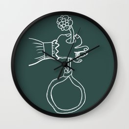 the river holds a flower . inversion Wall Clock