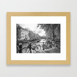 Bicycles parked on bridge over Amsterdam canal Framed Art Print