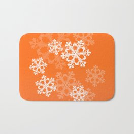 Cute orange snowflakes Bath Mat