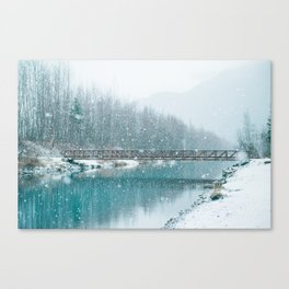 snow falls on the river Canvas Print