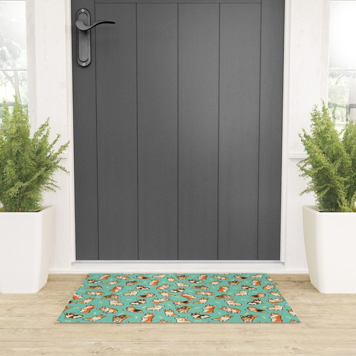 Jolly corgis in green Welcome Mat