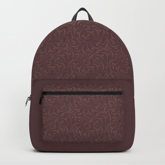 Warm , chocolate brown solid pattern . Chocolate . Backpack