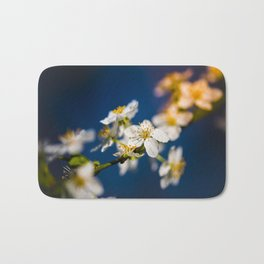 Beautiful White Jasmine Flowers With Green Leaves Against A Blue Background Bath Mat