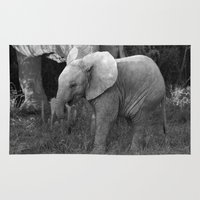 baby elephant Area & Throw Rugs featuring Baby Elephant by C. Bright
