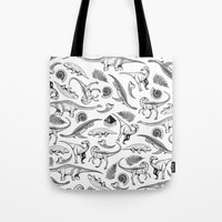 dinosaurs Tote Bags featuring Dinosaurs by La Lucha Eterna Custom Tattoo