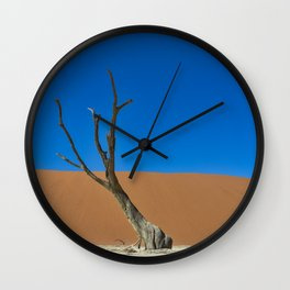 Lone desert tree on an Ancient River bed Wall Clock
