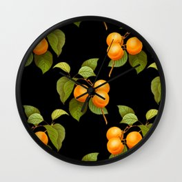 Peach pattern with leaves on a black background Wall Clock