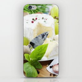 delicatessen soft cheese with grape and vegetables iPhone Skin
