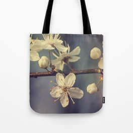 Cherry blossom tree in the blue Tote Bag