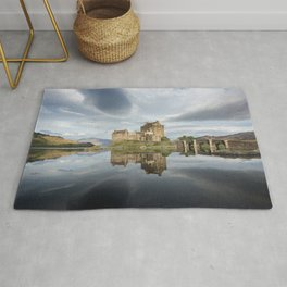 Eilean Donan castle with reflection in the water in Scotland Rug