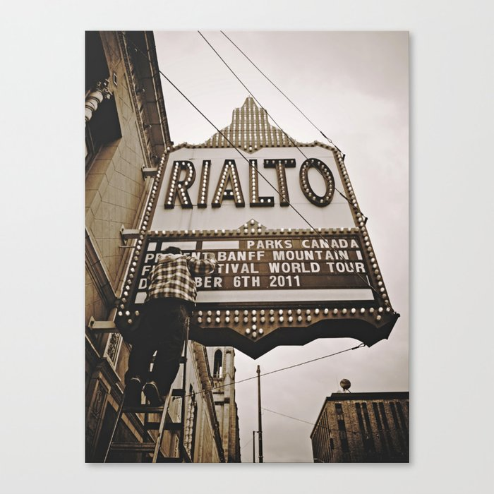 Guy changing sign Canvas Print