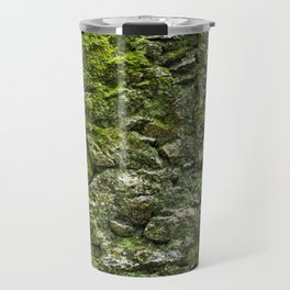 Green wall covered with moss and little plants Travel Mug