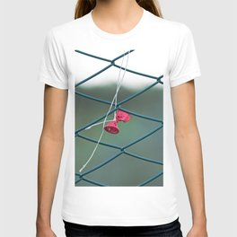 Deflated red balloon on fence net T-shirt