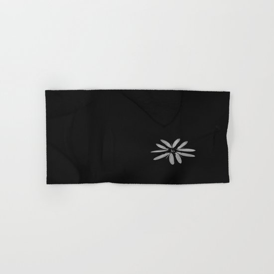 One Tiny White Flower on Black Background Hand & Bath Towel