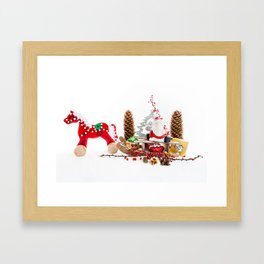 Santa Claus on wooden sled Framed Art Print