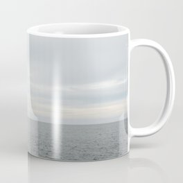 A small northumberland lighthouse stretched our to sea at dusk. Coffee Mug