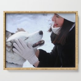 Young brunette female playing with her siberian husky outdoor. Serving Tray