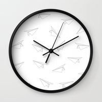 airplanes Wall Clocks featuring Paper Airplanes by brittcorry