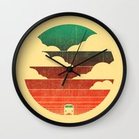 clouds Wall Clocks featuring Go West by Picomodi