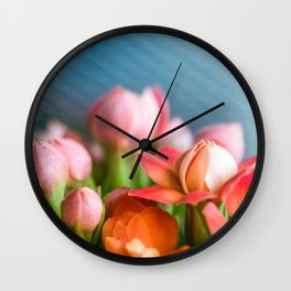 Beautiful Kalanchoe Blossfeldiana orange flowers with pink buds in macro Wall Clock