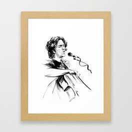 А man who sings and plays the cello Framed Art Print