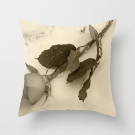 A lone rose resting in the snow Throw Pillow