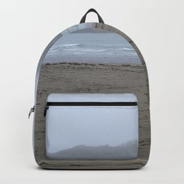 Walking on a foggy beach Backpack
