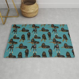 Black and Tan Coonhounds on Teal Rug