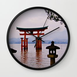 Tori in water Wall Clock