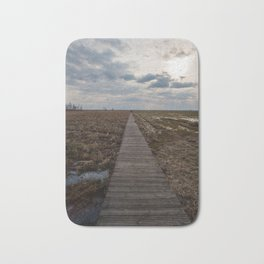 A wooden path over wetlands Bath Mat