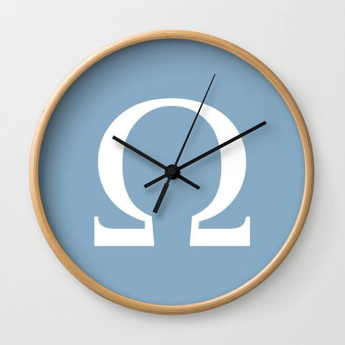 Greek letter Omega sign on placid blue background Wall Clock