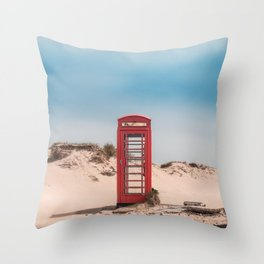 Red telephone box on a deserted beach Throw Pillow
