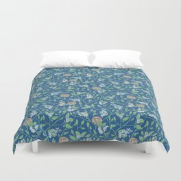 Branches with flowers and bird nests on blue background Duvet Cover