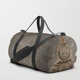 Sitting Buddha On Distressed Metal Background Duffle Bag
