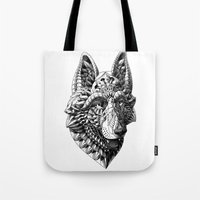 german shepherd Tote Bags featuring German Shepherd by BIOWORKZ