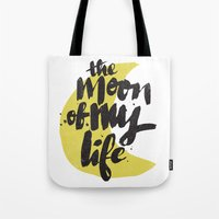 thrones Tote Bags featuring Moon by Matthew Taylor Wilson