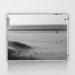 Beach in winter with some walkers Laptop & iPad Skin