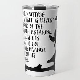 A bird sitting on a tree Travel Mug