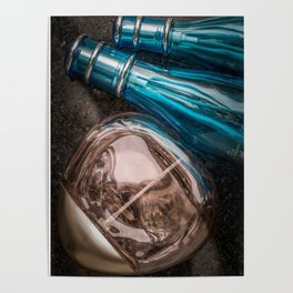 Three perfume bottles on dark background close view from above Poster