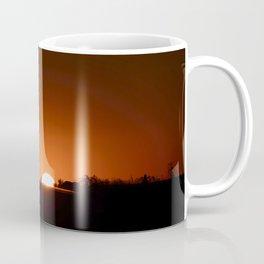 The sun goes down the road Coffee Mug