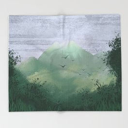 Volcano in the jungle Throw Blanket