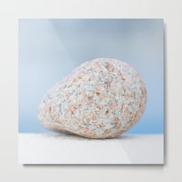 Granite pebble with blue water background Metal Print