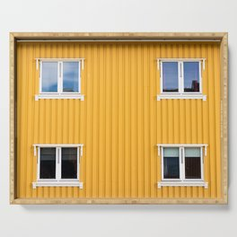 Yellow wooden wall pattern with four windows, outdoors, Norway. Serving Tray
