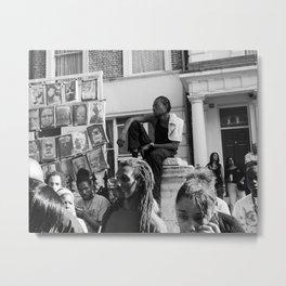 Man sitting on pillar in crowd, Notting Hill Carnival Metal Print