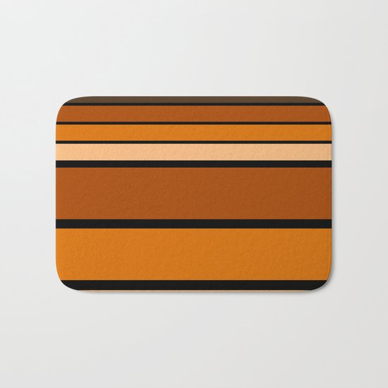 Black and yellow , brown and orange striped pattern . Bath Mat