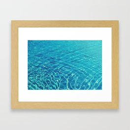 Ripples and wave patterns on crystal clear blue water Framed Art Print