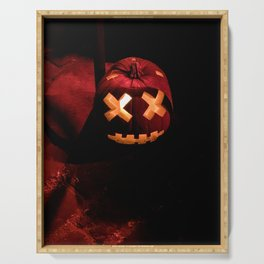 Photograph of a Scary, Carved Pumpkin Lit from the Inside at Halloween Serving Tray